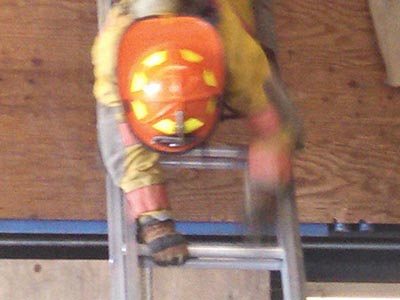 Firefighter on rock ledge